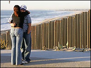 A Mexican couple hugs at the Mexico-U.S. border. Credit: Omar Torres/AFP/Getty Images