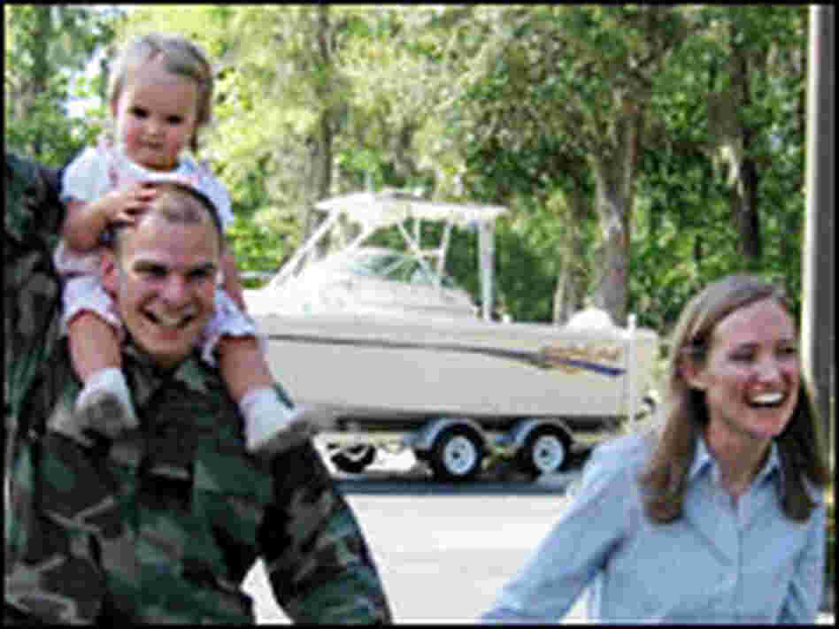 Capt. Jeff Townsend and his wife, Hunter, with their 14-month old daughter, Viola.