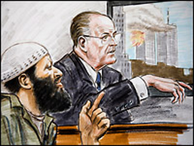 Zacarias Moussaoui (L) listens to former New York Mayor Rudolph Giuliani testify while a video of the Sept. 11 attacks plays in the background Thursday at the Federal Court in Alexandria, Va.