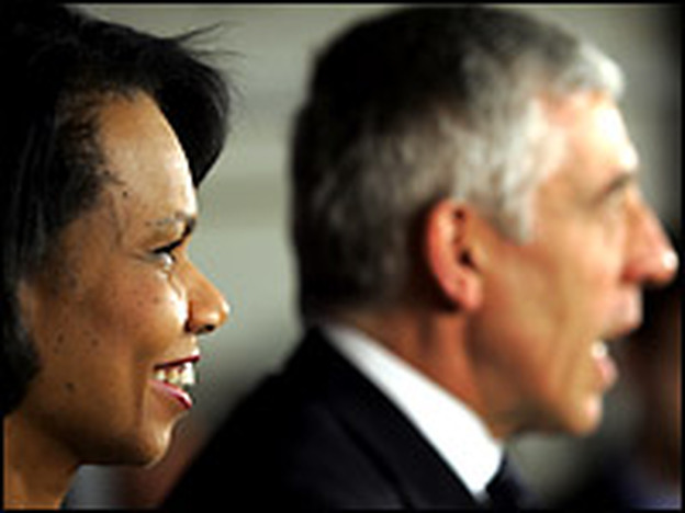 U.S. Secretary of State Condoleezza Rice smiles as British Foreign Secretary Jack Straw speaks during a joint press conference in Baghdad's heavily fortified green zone on Monday.