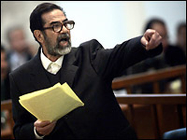 Former Iraqi President Saddam Hussien argues with prosecutors while testifying during his trial in Baghdad on Wednesday.