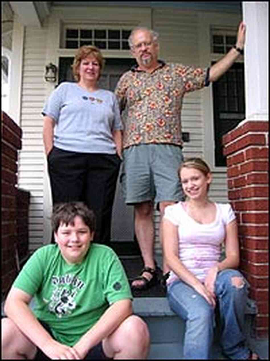 The Folse family in front of their home.