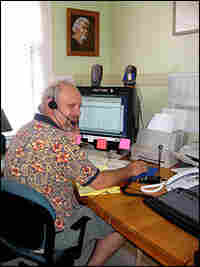 Mark Folse sits in his home office.
