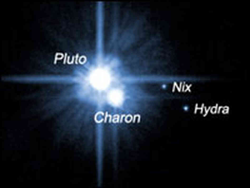 Pluto and its three known moons.