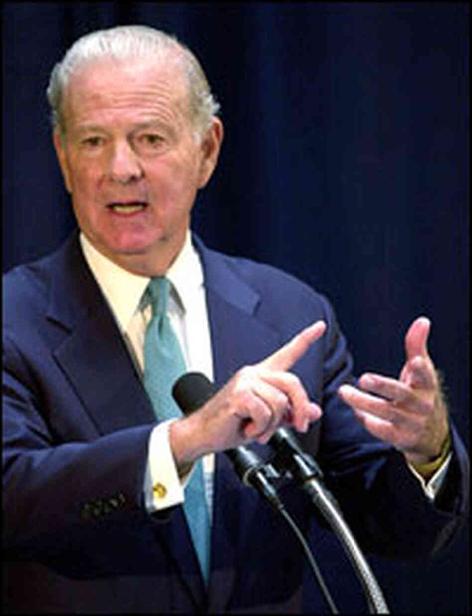 James Baker speaks with reporters at a November 2000 press conference in Tallahassee, Fla.
