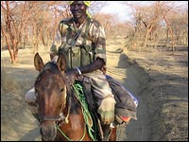 A Chadian government soldier rides from his base near the border with Sudan.