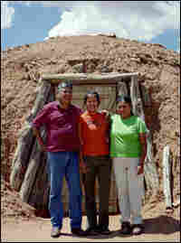 Bobby, Colleen and Ellen Cooley stand in front of the family's hogan.
