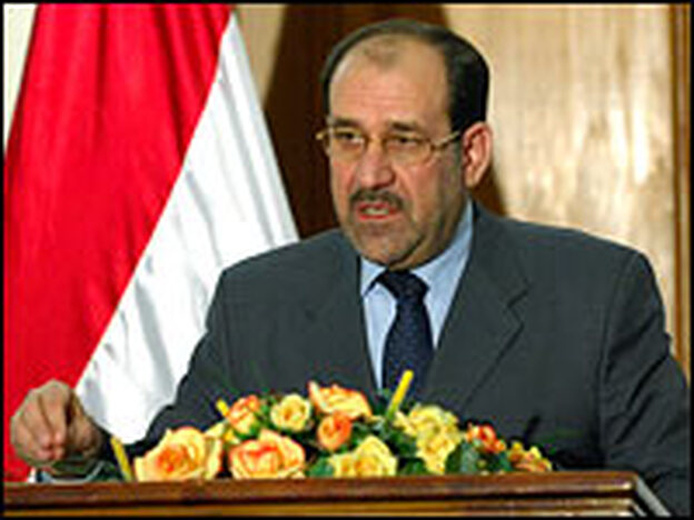 Iraqi Prime Minister Nouri al-Maliki attends a press conference in Baghdad, Dec.  5, 2006.