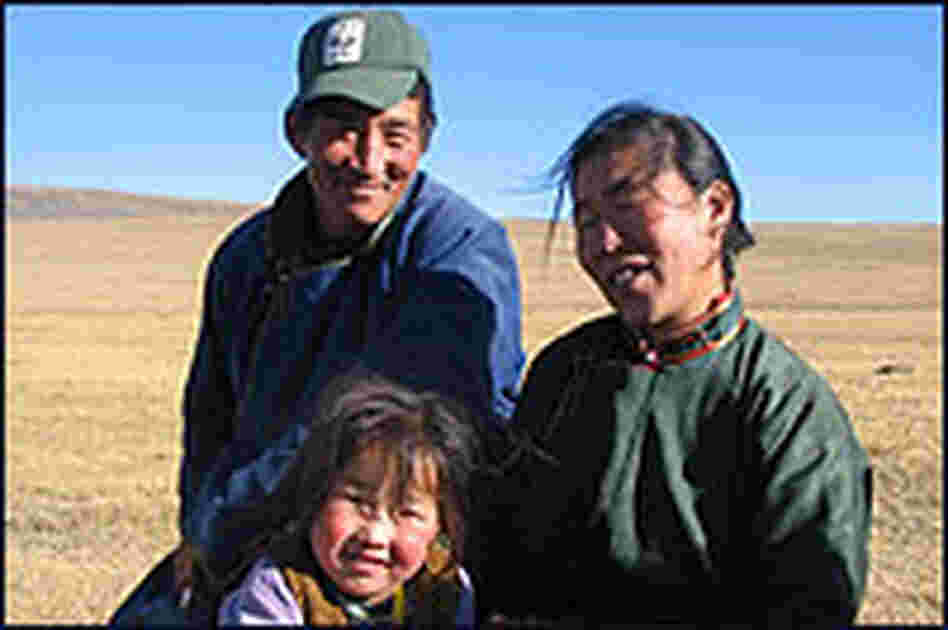 Erdenbaatar, a Mongolian wildlife ranger, with his wife and daughter