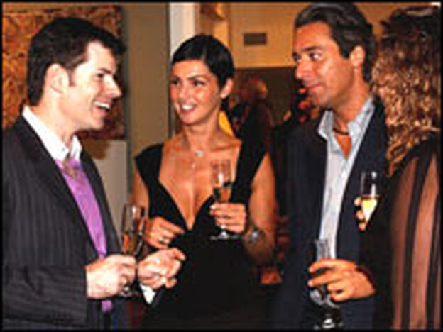 Host Thomas Lavin  (left) mingles with Alice Dzidic, Claudio Montanari and Janet Bussell at a 2003 party in West Hollywood, Calif.