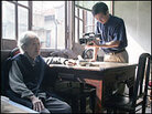 Shu Haolun films his grandmother in his family's old house.