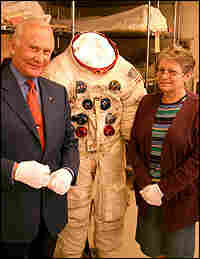 National Air and Space Museum specialist Amanda Young with Buzz Aldrin and his Apollo 11 spacesuit.