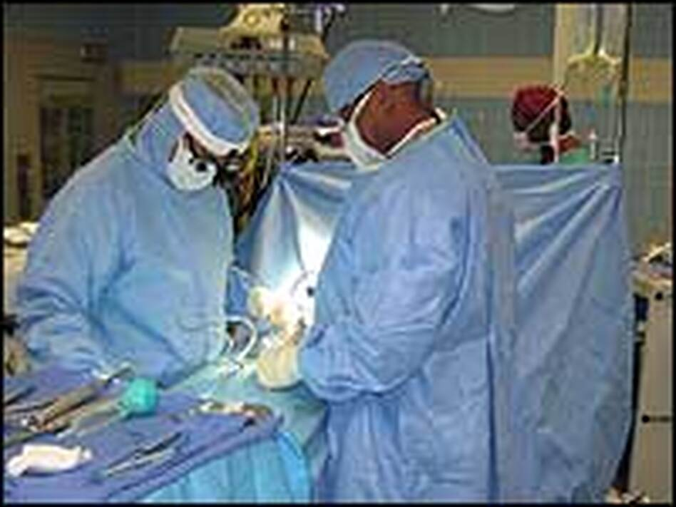 Orthopedic surgeon John Starr, left, performing a back surgery at Washington Hospital Center in Washington, D.C. Starr says that, in many cases, doing back surgery is easier than deciding whether back surgery should be done.