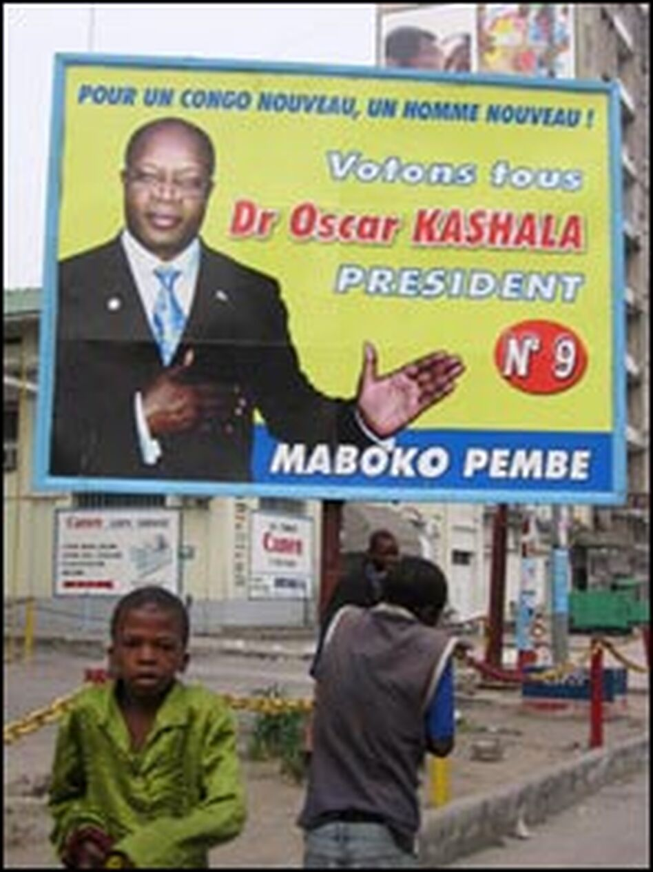 "A billboard for presidential candidate Oscar Kashala, whose campaign slogan is ""Clean Hands."" He says he had nothing to do with the previous dictatorial and corrupt regime or the warlords who took over."