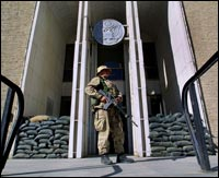 A Marine stands guard in front of the U.S. embassy in Kabul, Afghanistan, in 2001.