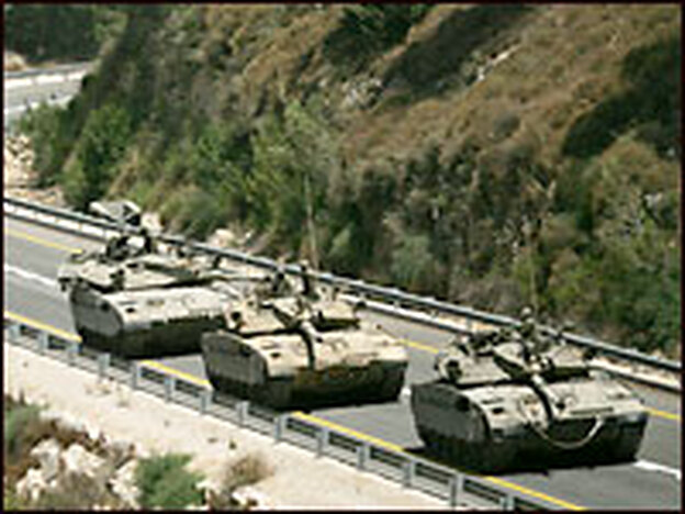 A convoy of Israeli tanks prepares to enter southern Lebanon near the northern Israeli village of Avivim.