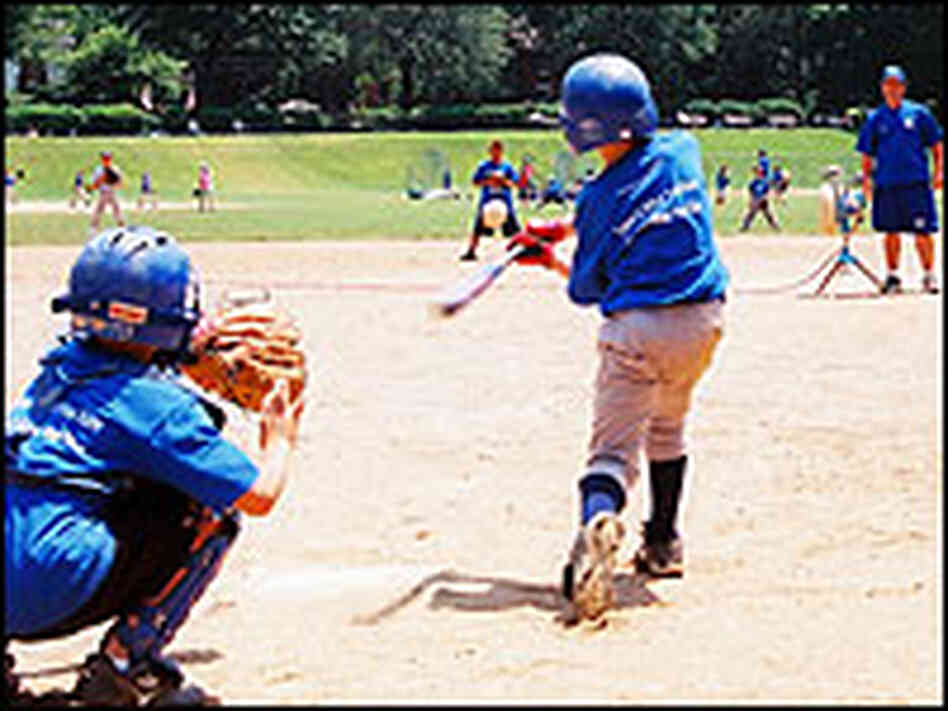Two campers at the plate at Friendship Park.