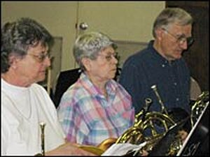 Members of New Horizons rehearse for a concert.