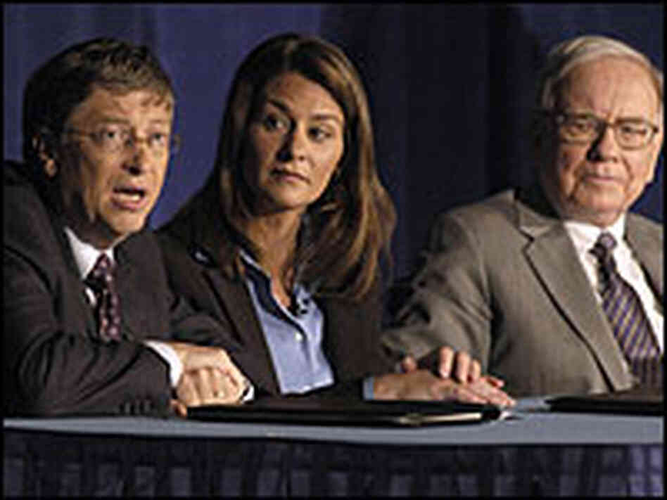 Bill and Melinda Gates, and Warren Buffet, right.