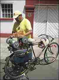 Porfirio Salinas has modified his bike to become a mobile knife sharpening shop.
