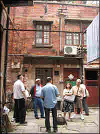 Dvir Bar-Gal (center, in blue shirt) leads a tour in Shanghai's Jewish ghetto.