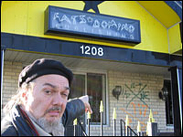 Dr. John points out Fats Domino's ruined house in New Orleans' Lower Ninth Ward. Domino is staying across the river in Algiers these days.