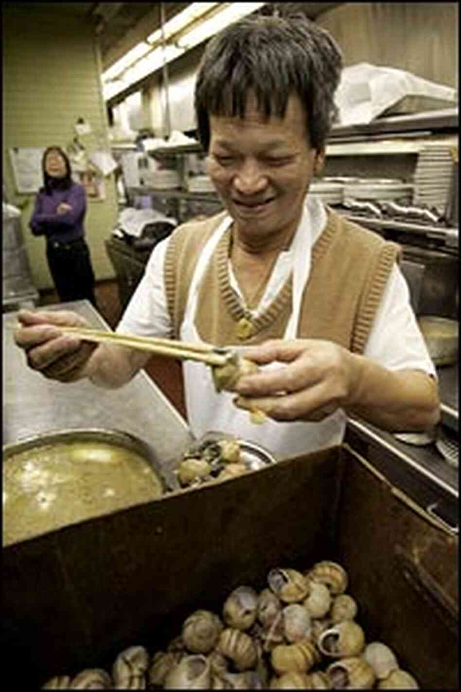 Kenny Auyeong prepares the Imperial Dynasty's famous escargot.