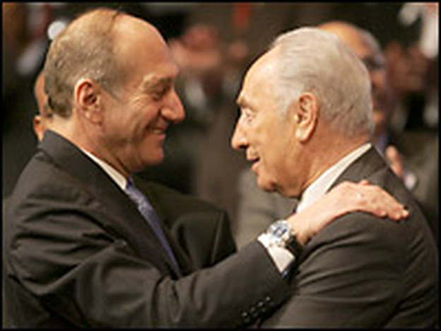 Acting Prime Minister and Kadima leader Ehud Olmert (L) celebrates the election results with former Prime Minister Shimon Peres early on Wednesday.