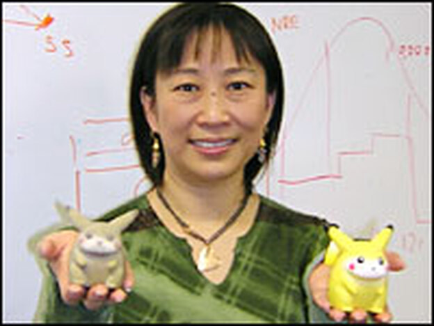 Ping Fu holds two Pikachu dolls. The one on the left was the first object ever created using Geomagic's technology, based on a scan of the doll on the right.