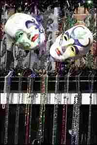 Decorations and beads hang on a balcony in Bourbon Street in the French Quarter of New Orleans the d
