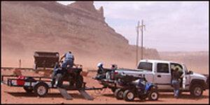 People preparing to ride an ATV in the desert. Credit: Richard Harris, NPR.