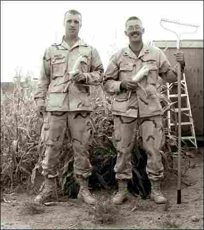 Sgts. Justin Wanzek and Carl Quam Jr. pose with their corn crop.