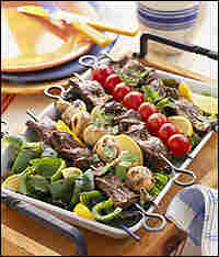 A summer grill of vegetables and kabobs.