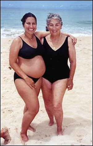 A pregnant Christina Salas-Porras Cardoza with her mother at the beach.
