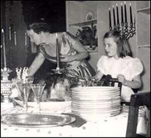 Peggy Knickerbocker helps her mother set the table.
