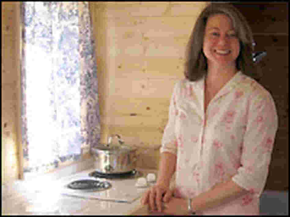 Julie Martin with her tiny home in Mississippi. Cheryl Corley, NPR.