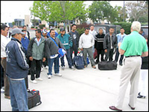 Controller John Demoss welcomes guest workers to Benchmark in San Diego. Credit: Scott Horsley, NPR.