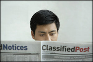 Man reading classified ads