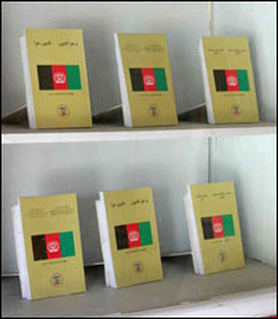Copies of Afghanistan's legal code fill a display case in the lobby of the Supreme Court building.