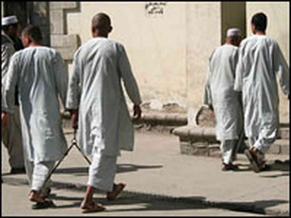 Prisoners file through the courtyard of Kabul's court center.