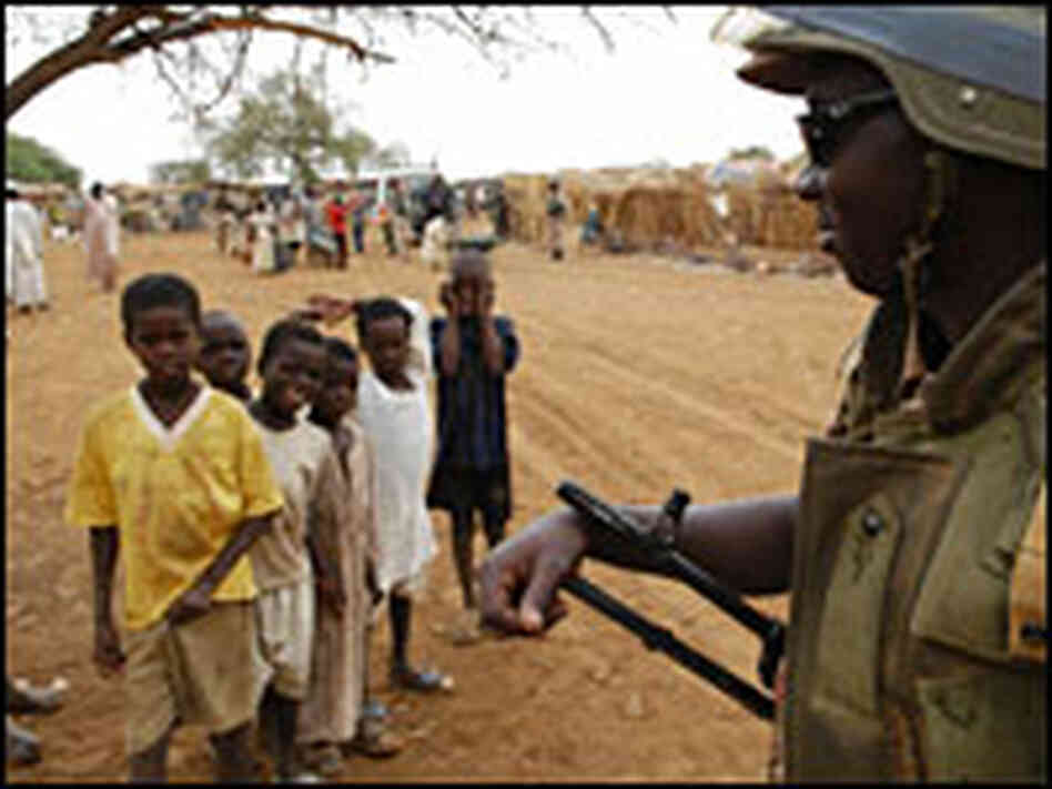 An African Union soldier patrols a camp for the internally displaced in the war-torn western region