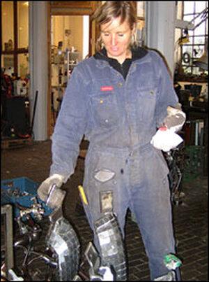 Charlotte Steem in a welding shop.