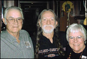 Farmer-ranchers Gordon and Helen Waller meet with Willie Nelson (center), co-creator of Farm Aid.