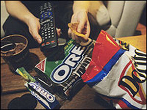 A junk food meal in front of a TV.