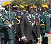Zimbabwean President Robert Mugabe inspects an honor guard in Harare.