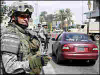 A U.S. soldier operates a checkpoint setup around the Karrada neighbourhood of central Baghdad on Tu
