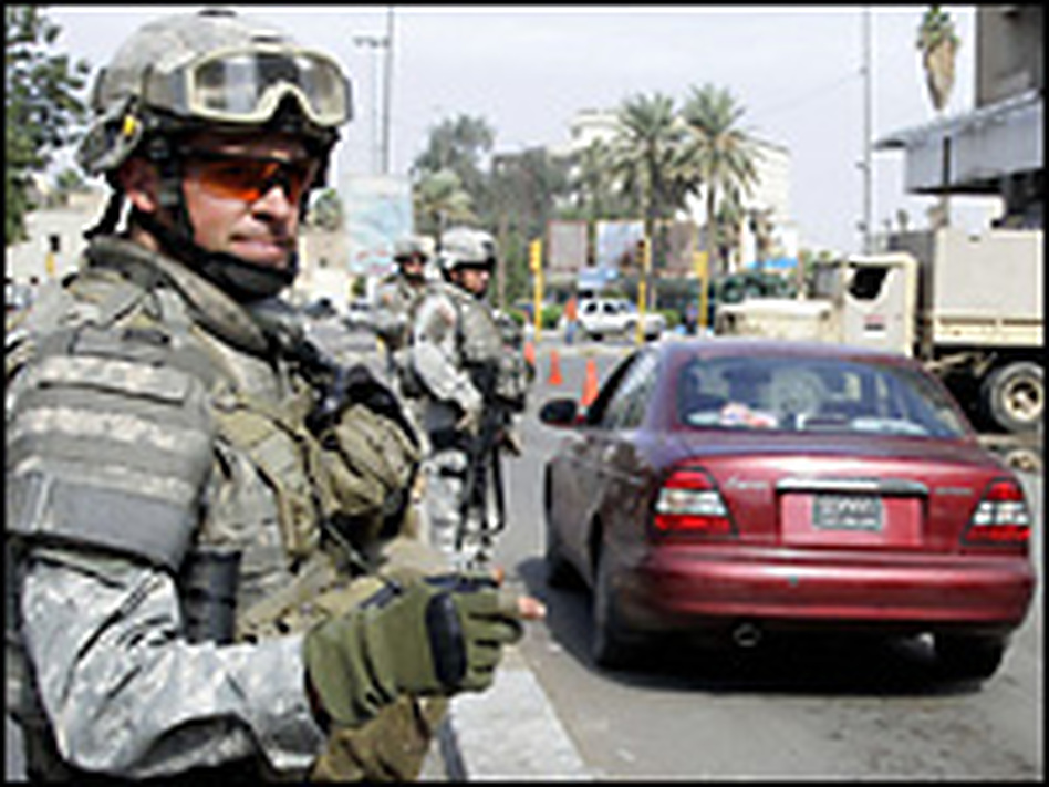 A U.S. soldier operates a checkpoint setup around Karrada in central Baghdad Tuesday.