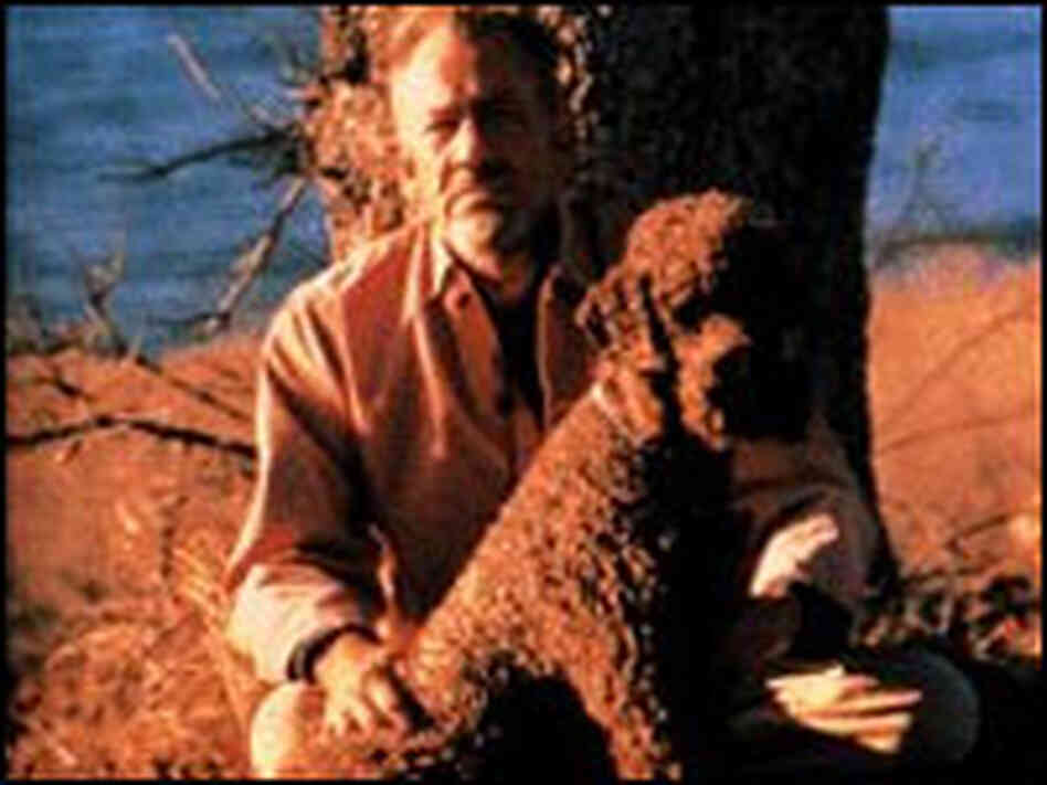 John Steinbeck and his poodle.