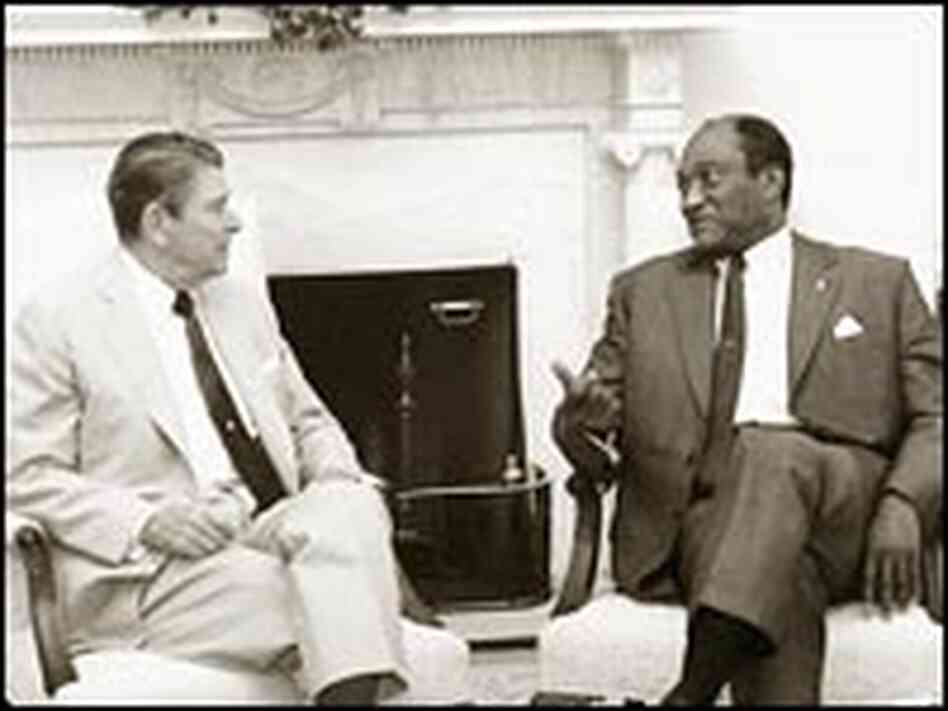 Edward Perkins meets with President Reagan in the Oval Office.