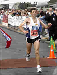 Mark Cucuzzella crosses the finish line at the Air Force marathon
